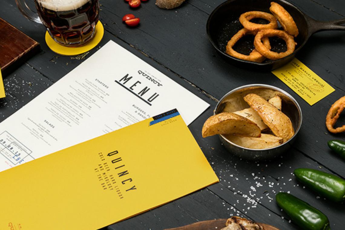 Желтое меню на столе
